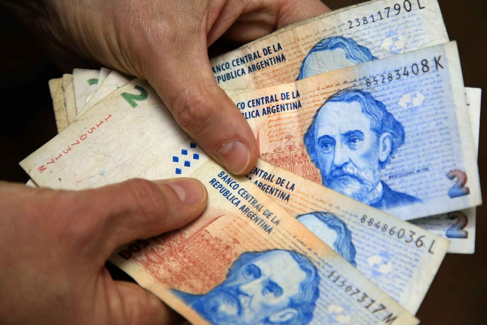 Chau, nos vemos: El agónico adiós a los billetes de $2