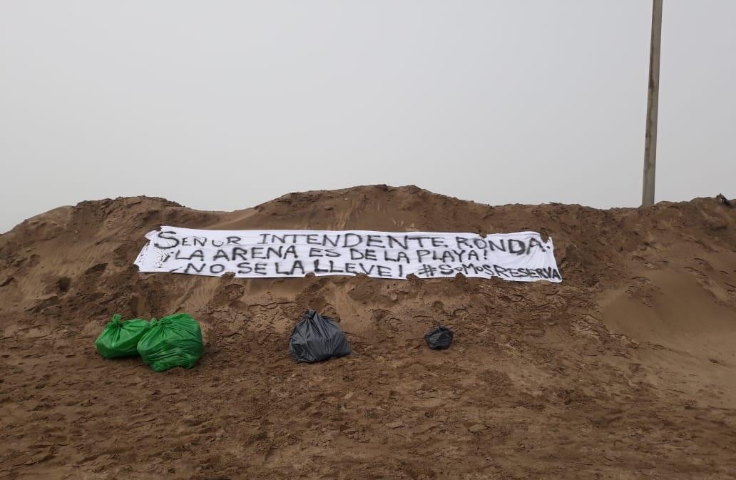 """Vecinos auto convocados se reunieron en """"la boca"""" de la albufera para pedir el cese de la extracción de arena"""